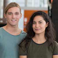 A female and male scholarship recipient stand together at the NeW Space Building